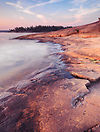 Landscape nature scenery of red rocks on a shore of Georgian Bay at dawn. Killbear Provincial Park, Ontario, Canada.