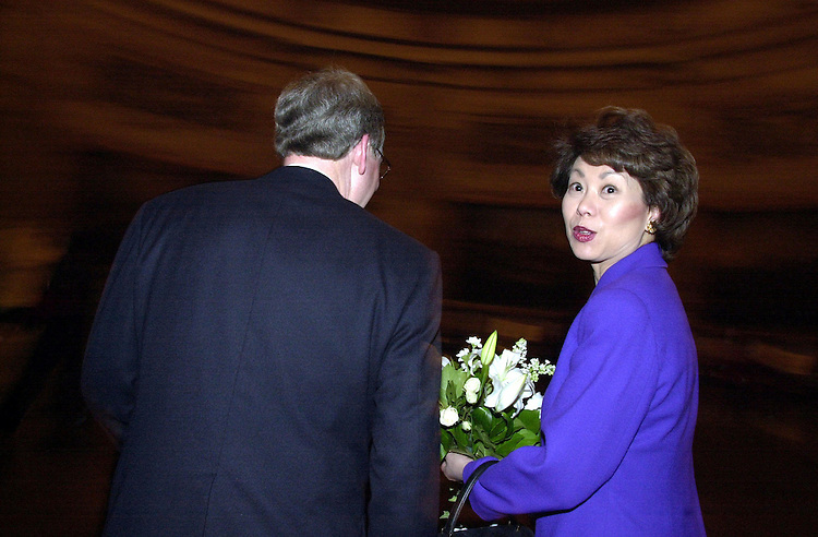 41joint022701 -- Sec. of Labor Elaine Chao and Sen. Mitch McConnell, R-KY, answers questions during an interview in the Capitol Rotunda on President Bush's address to the Joint Session of Congress.