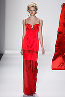 Model walks runway in a ruby silk satin silver screen siren gown w/silk organza bra top+garter insert, from the Zang Toi Fall 2012 &quot;Glamour At Gstaad&quot; collection, during Mercedes-Benz Fashion Week New York Fall 2012 at Lincoln Center.