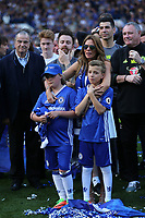 A tearful Toni Terry, wife of John Terry, puts her arm around children, Summer Rose and Georgie, as John makes a farewell speech on the pitch after the game during Chelsea vs Sunderland AFC, Premier League Football at Stamford Bridge on 21st May 2017