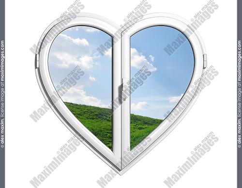 Summer nature behind a heart-shaped window