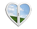 Summer nature behind a heart-shaped window