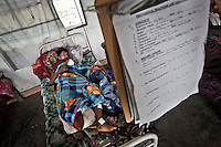 Lahpan Tang is a 25 years old KIA combatant who recovers from his injuries caused by landmine explotion when he clashed with the Burmese army in the Laiza front line, the stronghold city of the KIA rebel army. Fierce clashes have taken place since the ceasefire was broken out by the Burmese army last June 2011. During months the fighting were spread out along the Kachin State leaving more than 40,000 displaced persons and refugees (a conservative estimating) in accord with the humanitarian aid groups.