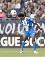 Philadelphia Union defender Sheanon Williams (25) heads the ball. In a Major League Soccer (MLS) match, the New England Revolution tied Philadelphia Union, 0-0, at Gillette Stadium on September 1, 2012.