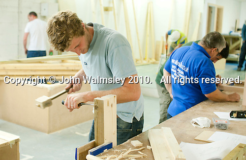 Using a mallet and chisel to prepare a joint on a window frame.   Able Skills in Dartford, Kent, runs courses in construction industry skills like, bricklaying, carpentry and tiling.