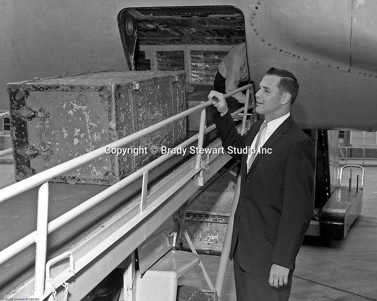Greater Pittsburgh International Airport:  View of Bob Purkey Sr. of the Cincinnati Reds arriving at the airport for a game with the Pittsburgh Pirates - 1960.  The on location photographic assignment was for United Airlines. The 1960 Cincinnati Reds finished in sixth place in the National League standings, 28 games behind the National League and World Series champion Pittsburgh Pirates!  The highlight for me in this set of images was of the one of Bob Purkey Sr.  I had the opportunity to know Bob Sr while playing high school baseball with his son, Bob Purkey Jr.  For many years, Bob Purkey Sr had a successful insurance business in Bethel Park Pa.