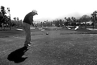 24 January 2009: 83 year old celebrity player Yogi Berra tees off on 8th hole at Palmer Private at PGA West in La Quinta, California during the fourth round of play at the 50th Bob Hope Chrysler Classic, PGA golf tournament.