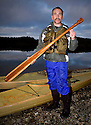 WA04270-00....WASHINGTON - Phil Russel kayak and paddle builder on the shore of Wescott Bay, San Juan Island. (MR R8)
