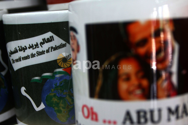 Coffee mugs stand for sale at a souvenirs shop in Gaza City as part of the campaign promoting the Palestinians' bid for statehood on September 14, 2011. The Palestinians are preparing to submit a formal request to become the 194th member of the United Nations when the General Assembly begins its meetings on September 20, despite US and Israeli opposition.  Photo by Ashraf Amra