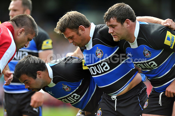 The Bath front row of Kane Palma-Newport, Lee Mears and Nathan Catt pack down for a scrum. Pre-season friendly match, between Bath Rugby and London Welsh on August 11, 2012 at the Recreation Ground in Bath, England. Photo by: Patrick Khachfe / Onside Images
