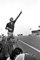 DETROIT, MI - JUNE 24: Michael Kranefuss of Germany, Director of Special Vehicle Operations for Ford Motor Company, celebrates after the Detroit Grand Prix SCCA Trans-Am race on the temporary street circuit in Detroit, Michigan, on June 23, 1984.