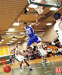 Waterbury, CT-19, January 2010-011910CM01 --   Crosby's BJ Kline leaps through the air after the ball during the first half.  To the left is Holy Cross' Rashan St. Just (#23).  The Crusaders of Holy Cross defeated the Crosby Bulldogs Tuesday night in Waterbury 78-77.   Christopher Massa Republican-American