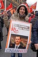 Rome, Italy. 16th January 2016<br /> Protester holding a sign with a picture of Syrian President Bashar al-Assad with the words: &quot;Sentenced&quot;,  during Anti-war demonstration on the 25th anniversary of the bombings in Iraq and against military spending, organized by the union USB, and the social platform Eurostop.
