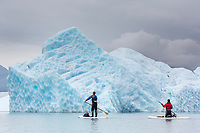 Paddle boarding among icebergs in Bear Glacier Lagoon, Kenai Fjords National Park, southcentral, Alaska.