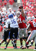 Ohio State Buckeyes defensive tackle Joel Hale (51) knocks the pass from Buffalo Bulls quarterback Joe Licata (16) down during the 1st quarter at Ohio Stadium in Columbus on August 31, 2013. (Dispatch photo by Kyle Robertson)