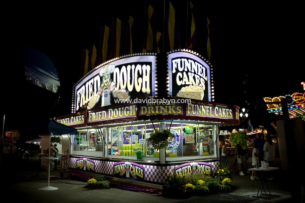 View of a fried dough and funnel cake food vendor stand at the North Carolina State Fair in Raleigh, NC, United States, 16 October 2008.