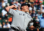 New York Yankees pitcher Boone Logan (48) works in the eighth inning against the Baltimore Orioles at Oriole Park at Camden Yards in Baltimore, Maryland in the first game of a doubleheader on Sunday, August 28, 2011.  The Orioles won the game 2 - 0..Credit: Ron Sachs / CNP.(RESTRICTION: NO New York or New Jersey Newspapers or newspapers within a 75 mile radius of New York City)