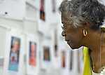 A woman surveys photos and descriptions on a timeline of Methodist women leaders at the United Methodist Women Assembly in the Kentucky International Convention Center in Louisville, Kentucky, on April 25, 2014.