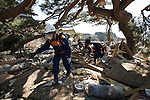 Police search through the rubble for people still missing following the March 11 magnitude 9 quake and subsequent tsunami in the grounds of Jodo-ji temple in Rikuzentakata, Iwate Prefecture, Japan on April 6, 2011..