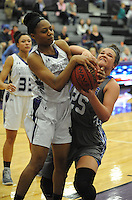 NWA Democrat-Gazette/ANDY SHUPE<br /> Rogers forward Madison Sandor and Fayetteville guard Wyvette Maybetter vie for a loose ball Friday, Feb. 10, 2017, during the second half of play in Bulldog Arena. Visit nwadg.com/photos to see more photographs from the game.
