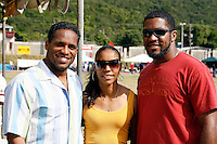 Ato Bolden, Torri Edwards and fan at the Douglas Forrest Track Meet held at Stadium East in Kingston,Jamaica on Saturday, January 12, 2008. Photo by Errol Anderson,The Sporting Image..