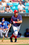 18 March 2006: Nick Johnson, first baseman for the Washington Nationals, watches the ball clear the fences during a Spring Training game against the New York Mets at Space Coast Stadium, in Viera, Florida. The Nationals defeated the Mets 10-2 in Grapefruit League play...Mandatory Photo Credit: Ed Wolfstein Photo..