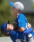 ORIG./Ryan Brennecke/The Bulletin/07-03-10..Zack Cole, left, hugs his teammate Cade Gienger after the Crook County All-Stars defeated the Bend North All-Star team during the District 5 Little League Tournament Saturday at Lava Ridge Elementary.