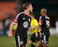 Taylor Kemp (33) of D.C. United reacts to a missed goal during a Major League Soccer game at RFK Stadium in Washington, DC.  New England defeated D.C. United, 2-1.
