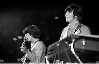 John Lennon and George Harrison preforming with the Beatles in 1965 concert at the Cow Palace in San Francisco, Ca. (photo/Ron Riesterer)