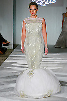 Model walks the runway in a Beth Elis Shooting Star wedding dress by Nere Emiko during the Wedding Trendspot Spring 2011 Press Fashion, October 17, 2010.