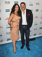 guest &amp; Reza Farahan.Bravo's Andy Cohen's Book Release Party For &quot;Most Talkative: Stories From The Front Lines Of Pop Held at SUR Lounge, West Hollywood, California, USA..May 14th, 2012.full length suit jacket white shirt jeans denim moustache mustache facial hair black dress beige.CAP/ADM/KB.&copy;Kevan Brooks/AdMedia/Capital Pictures.