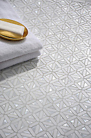 Joie, a water jet mosaic shown in polished Cloud Nine, Dolomite and Shell, is part of the Aurora™ Collection by Sara Baldwin for New Ravenna.