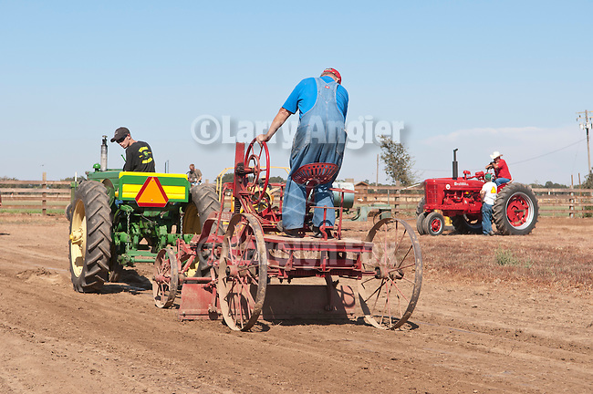 Annual fall Gas-Up at McFarland Ranch near Galt, Calif. of Branch 13, Early-Day Gas Engine and Tractor Association. (EDGE & TA)..John Deere model MT pulls vintage Little Western Steel Grader to prep the tractor pull track