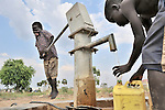 Children obtain water for their families from a well installed by the United Methodist Committee on Relief (UMCOR) in Yei, a town in Central Equatoria State in Southern Sudan.