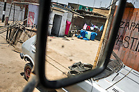 Plastic barrels, used for water storage, are seen in the rear mirror of a water truck distributing drinking water in Pachacútec, a desert suburb of Lima, Peru, 20 January 2015. Although Latin America (as a whole) is blessed with an abundance of fresh water, having 20% of global water resources in the the Amazon Basin and the highest annual rainfall of any region in the world, an estimated 50-70 million Latin Americans (one-tenth of the continent's population) lack access to safe water and 100 million people have no access to any safe sanitation. Complicated geographical conditions (mainly on the Pacific coast), unregulated industrialization (causing environmental pollution) and massive urban poverty, combined with deep social inequality, have caused a severe water supply shortage in many Latin American regions.