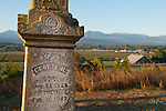 Grave stone of George Lotzgesell, a member of one of the pioneer farm families which settled the Dungeness valley in Sequim in the 1860s. The Lotzgesell farm, once 1000 acres, is still active and can be seen in the valley here, with its 100 year old barn.