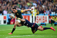 Jesse Kriel of South Africa is tackled by Zack Test of the USA. Rugby World Cup Pool B match between South Africa and the USA on October 7, 2015 at The Stadium, Queen Elizabeth Olympic Park in London, England. Photo by: Patrick Khachfe / Onside Images