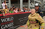 Vancouver, Canada, Aug 6th 2009.  World Police and Fire Games, Ultimate Firefighter Competition.   A competitor approaches the finish line while dragging the dummy through the obstacle course.   Photo by Gus Curtis