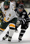 5 January 2007: University of New Hampshire forward Jacob Micflikier (9) from Winnipeg, MB, battles University of Vermont defenseman Kenny Macaulay (6) from Baddeck, NS, during a game at Gutterson Fieldhouse in Burlington, Vermont. The UNH Wildcats defeated Vermont 7-1 in front of a record setting 48th consecutive sellout at &quot;the Gut&quot;...Mandatory Photo Credit: Ed Wolfstein Photo.<br />