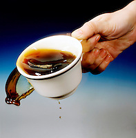 PERIODIC DISTURBANCE IN A COFFEE CUP<br /> (Variations Available)<br /> Surface Wave Created By Vibration From Walking. The vibration from walking creates a surface wave in the coffee cup. As the wave approaches the cup rim, liquid drags at the bottom and the crest spills over the top.