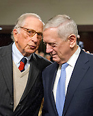 Former United States Senator Sam Nunn (Democrat of Georgia), left, and US Marine Corps General James N. Mattis (retired), right, share a thought prior to the US Senate Committee on Armed Services confirmation hearing on Mattis' nomination to be US Secretary of Defense on Capitol Hill in Washington, DC on Thursday, January 12, 2017.  Dunn, who served as Chairman of the US Senate Armed Services Committee from 1987 until 1995, introduced and endorsed Mattis.<br /> Credit: Ron Sachs / CNP