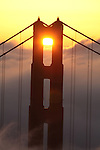 The rising sun played with San Francisco's Golden great bridge is a iconic landmark along with its closest neighbor, the fog.