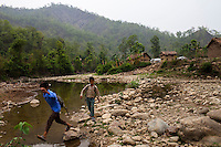School children walk along a river on the way to class in the remote village of Dungi Khola, near Chhinchu, Surkhet district, Western Nepal, on 1st July 2012. In Surkhet, Save the Children partners with Safer Society, a local NGO which advocates for child rights and against child marriage. Photo by Suzanne Lee for Save The Children UK