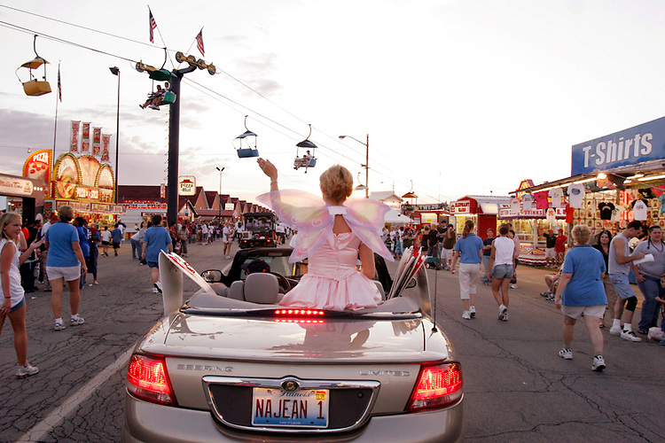 Illinois State Dental Society tooth fairy Gloria Pitchford of Girard, Ill., waves to Illinois State Fairgoers as part of the Twilight Parade.
