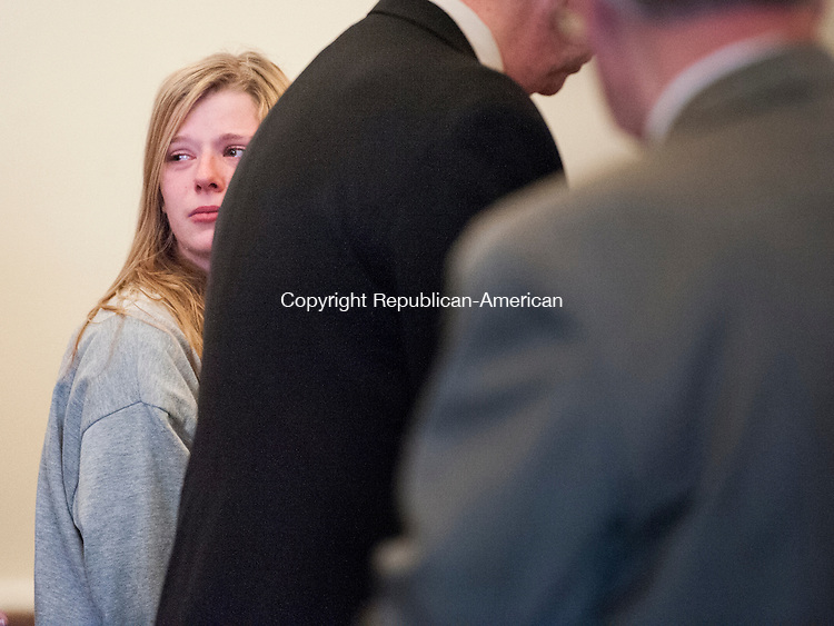 LITCHFIELD, CT-1 May 2015-050115EC01-  Heather Birden looks back at her family with tears in her eyes after she is charged with murder Friday morning in Litchfield Superior Court. The 20-year-old is accused of killing Holly Aeschlimann, 19, on April 17 in Torrington. Erin Covey Republican-American