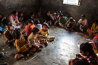 Students do an art class in the Guria Non-Formal Education center in the middle of the Shivdaspur red light district, Varanasi, Uttar Pradesh, India on 20 November 2013. Women in Prostitution working and living in the Shivdaspur red light area send their children to the centre run by Guria in hope that their children will get a better education and break the cycle of generational prostitution and trafficking.