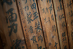 """Photo shows the """"gakuya"""" dressing room area of Korakukan theater, Japan's oldest extant wooden playhouse in Kosaka, Akita Prefecture Japan on 19 Dec. 2012. On the walls is the graffiti -- written by actors -- for which the theater is also famed. Made entirely from wood, the theater was opened in 1910 and was registered as an Important Cultural Property in 2007. Photographer: Rob Gilhooly"""