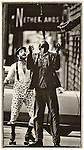 A street mime is upstaged by a man waiting for a bus in Kansas City Missouri, 1978.