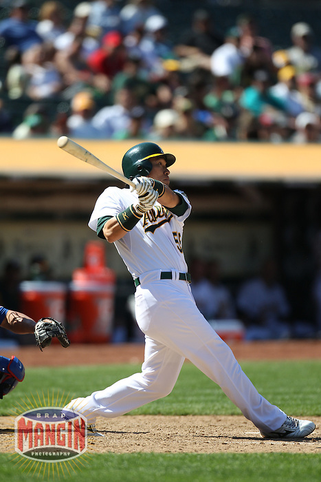 OAKLAND, CA - MAY 2:  Hideki Matsui #55 of the Oakland Athletics hits a game-winning home run in the bottom of the 10th inning against the Texas Rangers during the game at the Oakland-Alameda County Coliseum on May 2, 2011 in Oakland, California. Photo by Brad Mangin