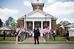 April 15, 2008. Wallace, NC..Funeral services were held for National Guard Staff Sgt. Emanuel Pickett at the 1st Baptist Church in Wallace, NC., where he was a police officer.. SSgt. Pickett was killed on April 6, 2008 in Baghdad, Iraq by indirect enemy fire. He was assigned to the 1132nd Military Police Company, North Carolina Army National Guard, Rocky Mount, N.C. and is the 8th North Carolina National Guard soldier killed in the wars in Iraq and Afghanistan..  Members of the Patriot Guard, a motorcycle group that escorts the remains of soldiers and protects the families from protesters, line the walk way to the church as a member of the funeral home waits for mourners arrive.